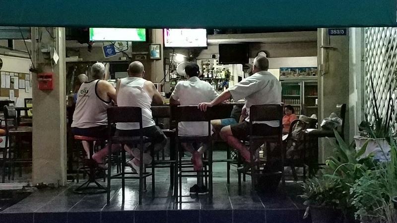 Men in a Bar Watching Sport